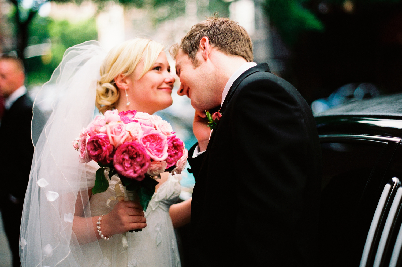 Bride smiling pink bouquet
