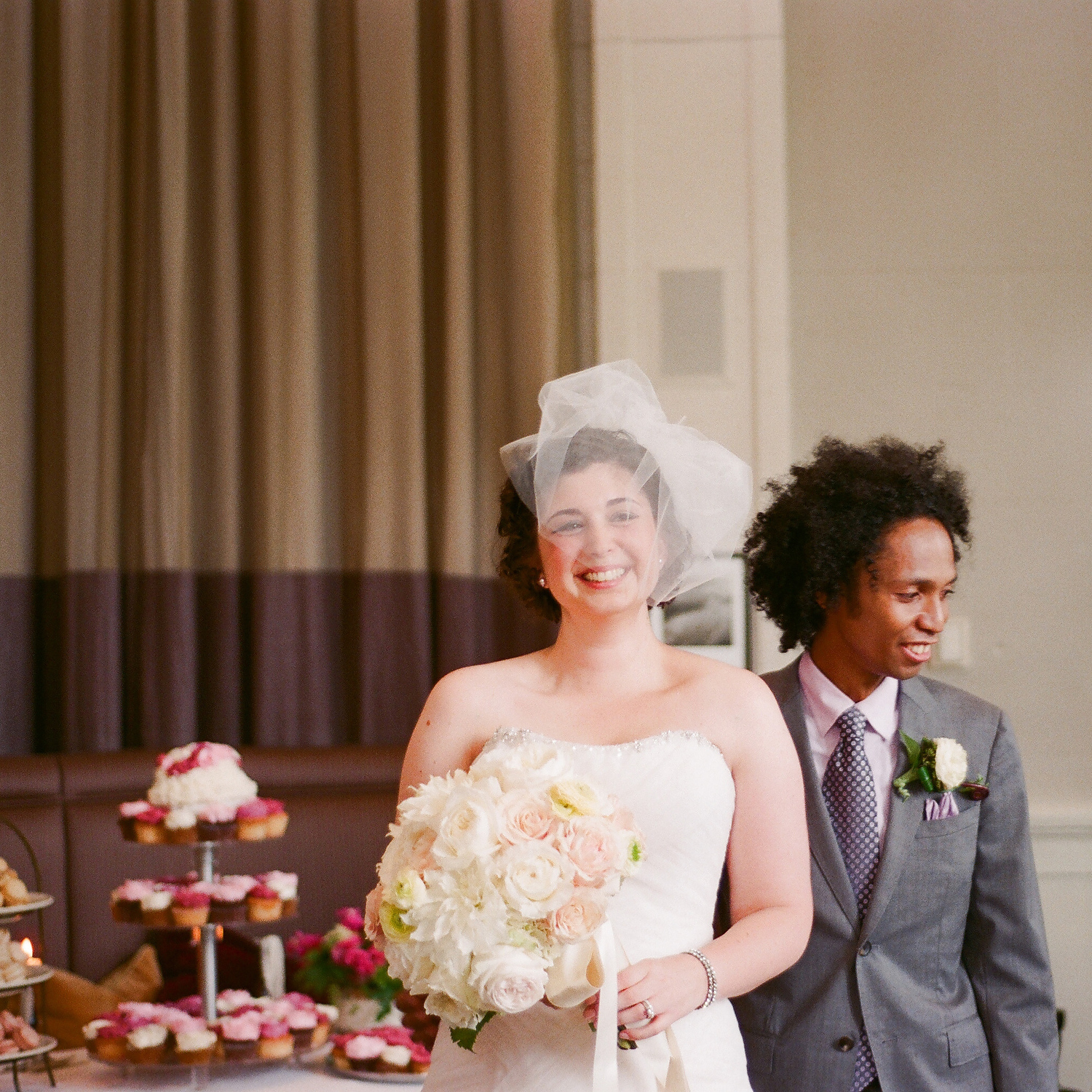 film wedding photograph of white bride and black groom