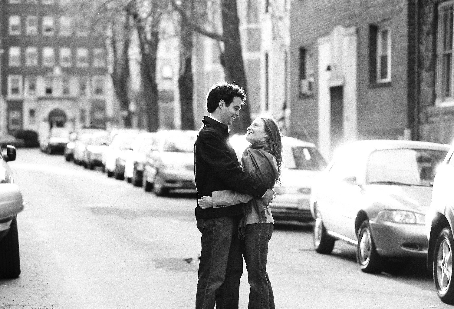 couple looking at each other city street in black and white